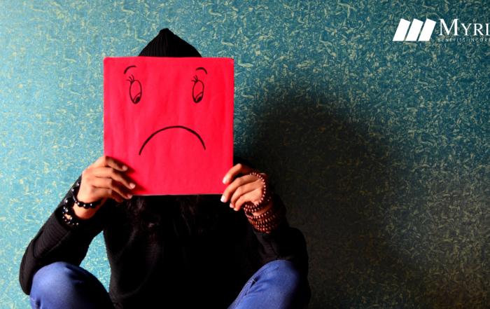 persona representando la depresión con un cartel